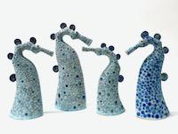 Photo of Four spotty sea horses